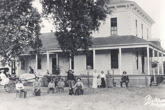 The Salmina family in front of the neighboring Tucker family homestead.