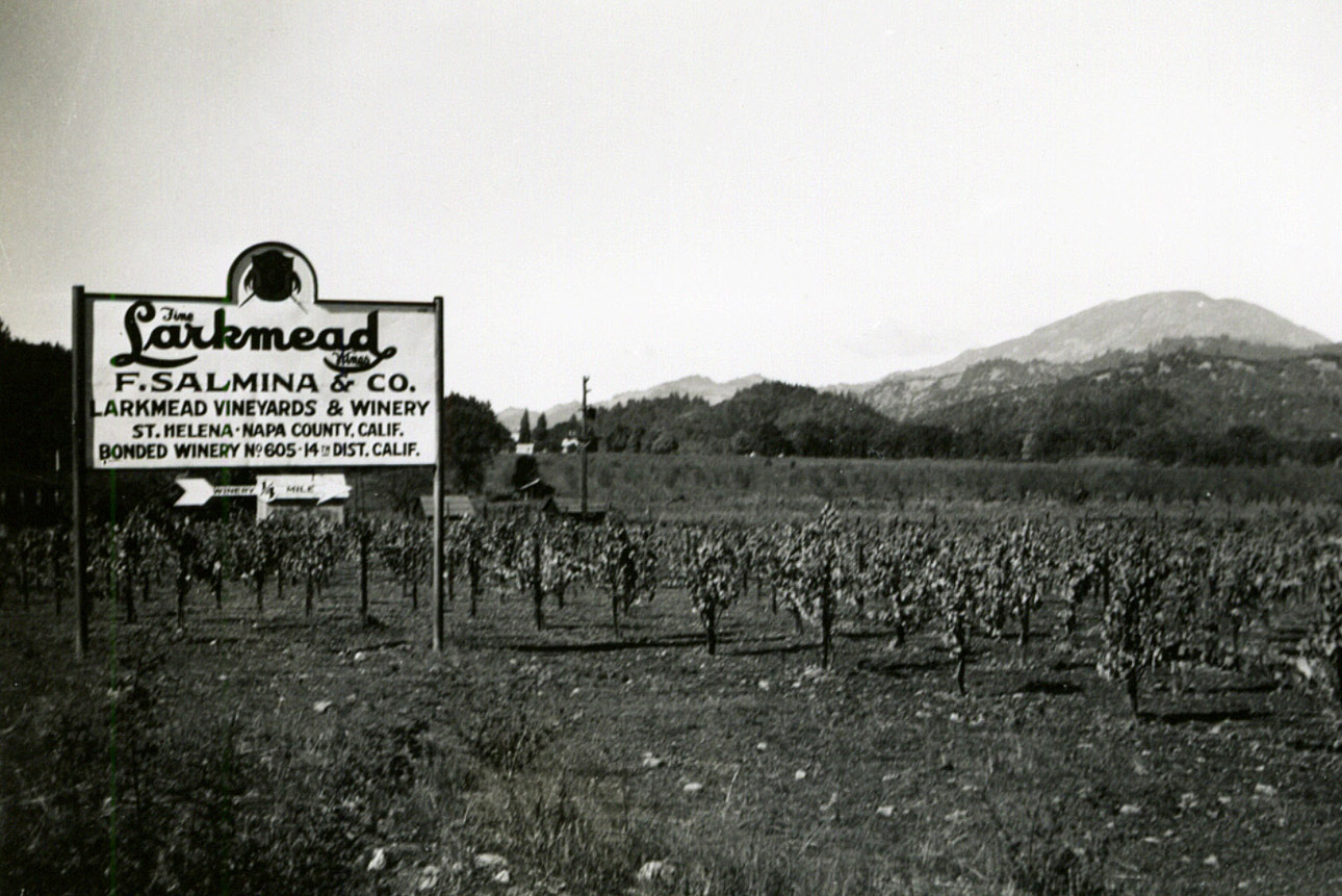 A sign points right for Larkmead Vineyards & Winery, F. Salmina & Co, St. Helena, Napa County, Calif. Bonded Winery No. 605, 14th District, Calif.