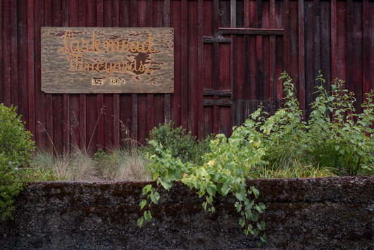 The original Larkmead Vineyards sign proudly displayed at our historic barn.